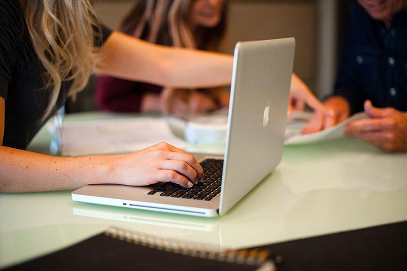 Creating social media content calendar on laptop